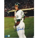 "Rickey Henderson Oakland Athletics Autographed ""Holding Bat"" 8"" x 10"" Unframed Photograph"