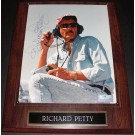"Richard Petty ""Sitting"" Autographed Racing 8"" x 10"" Photograph on a wall plaque"