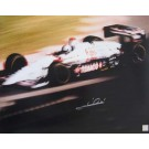 "Mario Andretti Autographed ""Texaco Blur"" 16"" x 20"" Photograph (Unframed)"